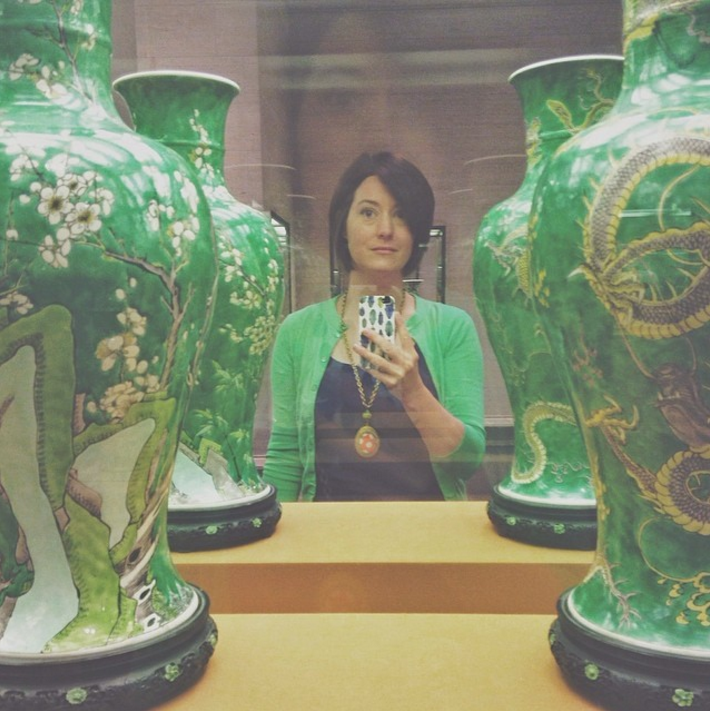 That's me. At work. I am a museum registrar by day at the National Gallery of Art and was happy to notice how coordinated I was with some works in our Asian collection that day. I don't take selfies often but occasionally I do like to post one so my friends and followers know who the person is behind the lens.