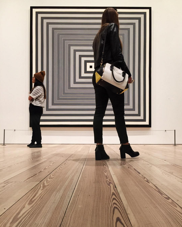 On a recent visit to NYC I made sure to stop in to the newly opened Whitney Museum of American Art. The museum had relocated from their old building and one of the early exhibitions in the new building was a retrospective of Frank Stella's work. The manner in which the staircases were designed in the building allowed me to get this low perspective of art watchers.
