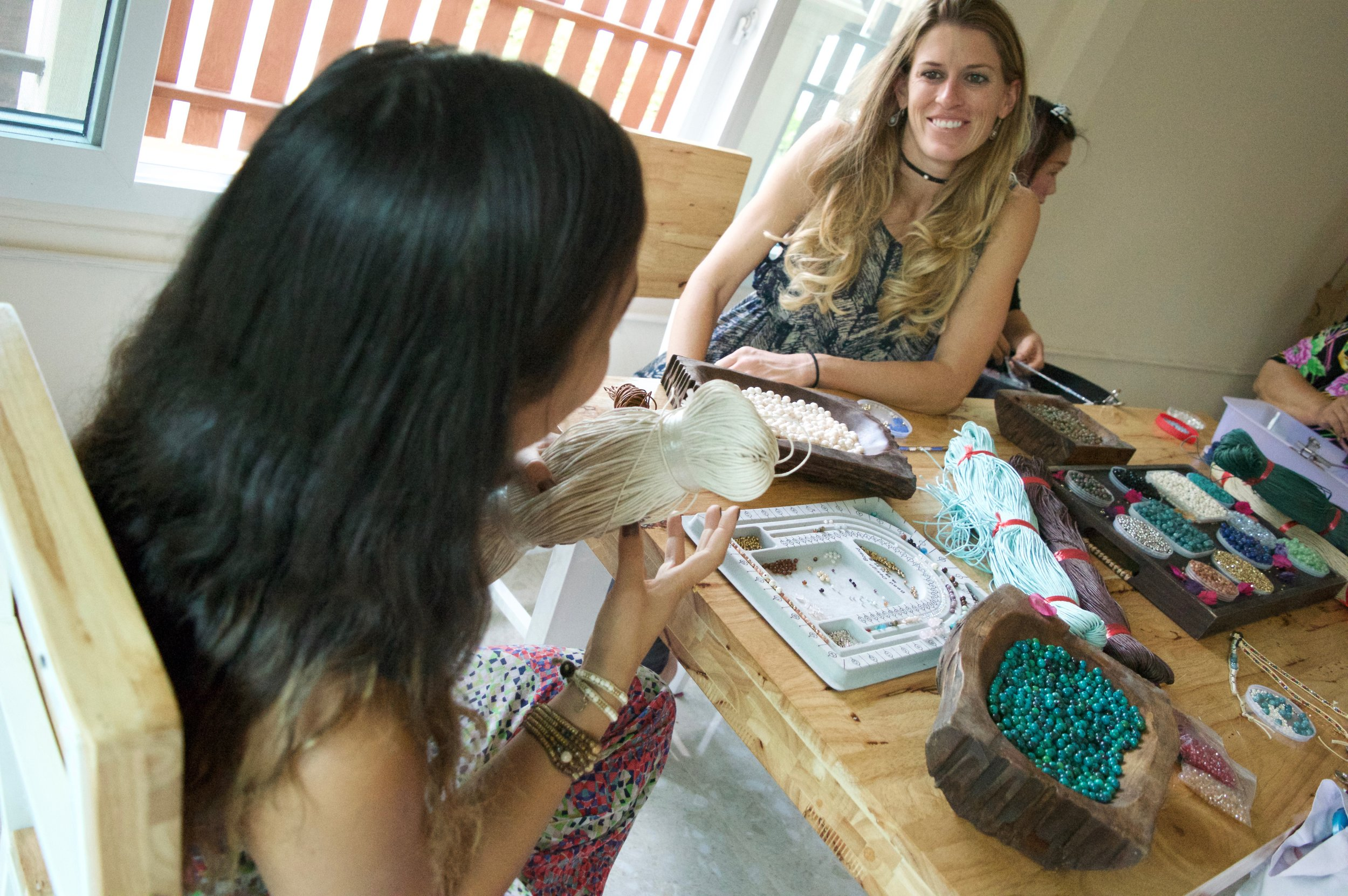 Janelle with the local artisans in Thailand.