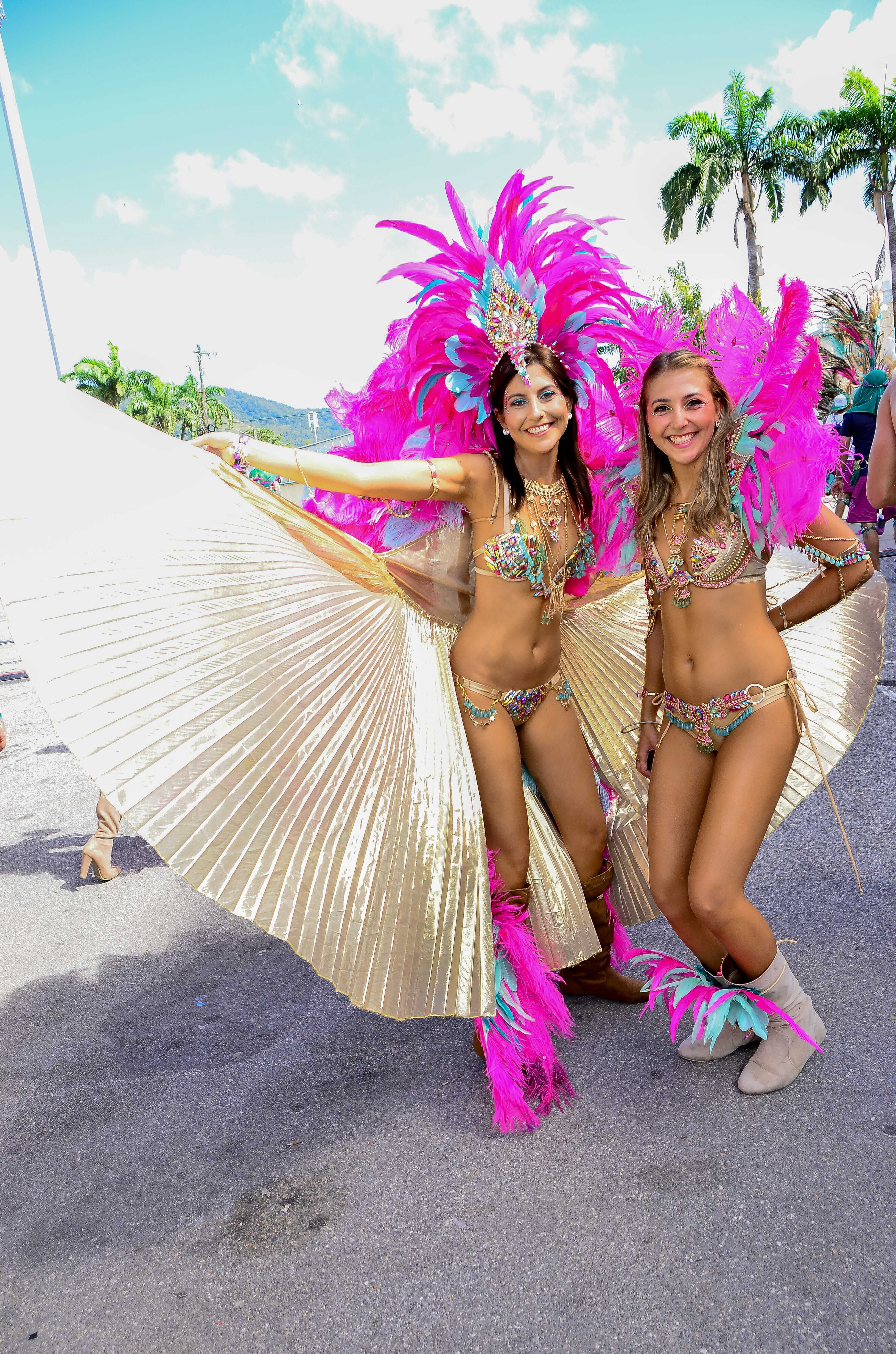 Carnival in Trinidad with two girls in feathered costumes