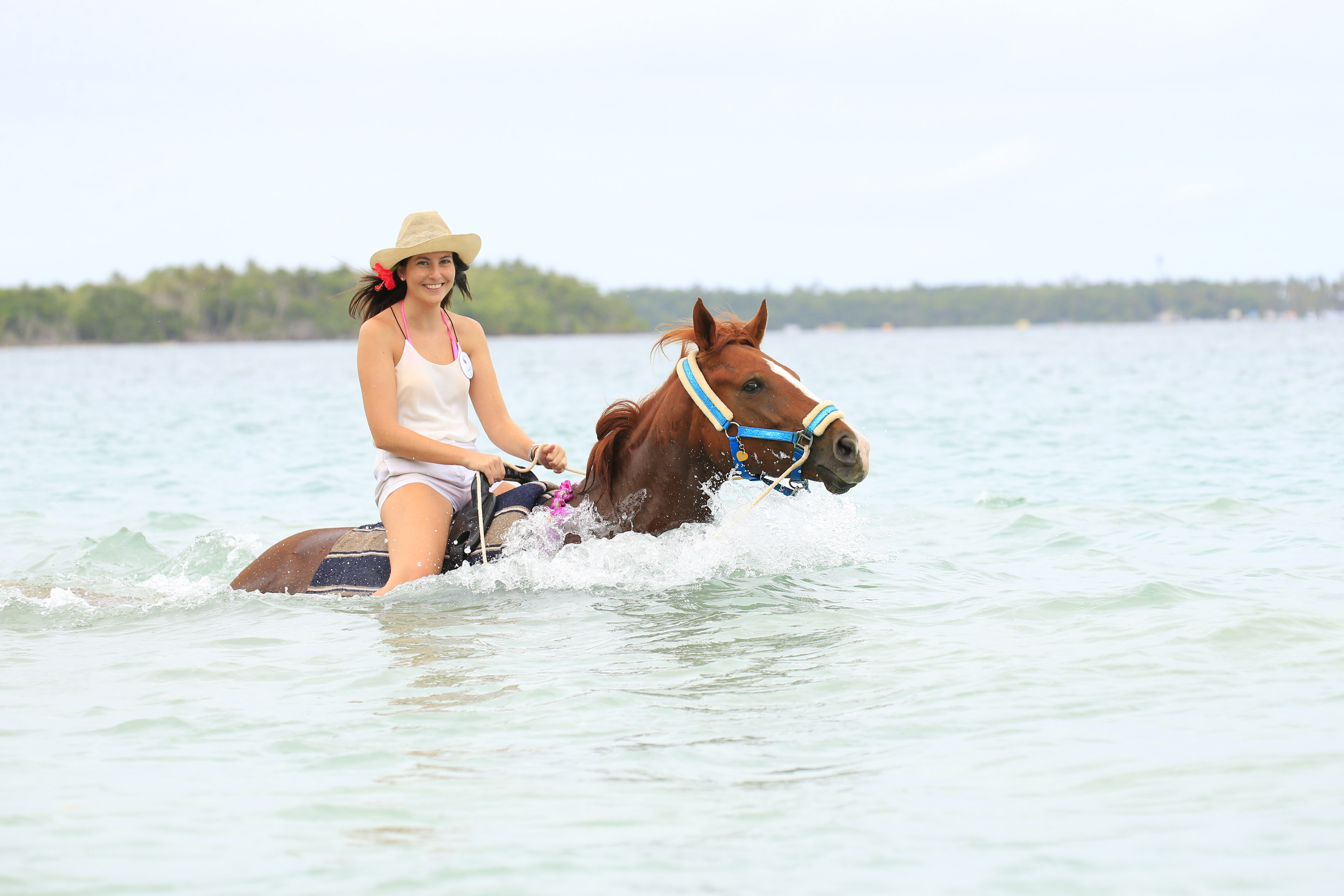 Trinidad and Tobago girl on horse in the water
