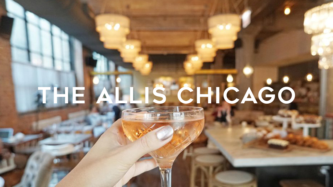 The Allis Chicago lifting a glass of rose