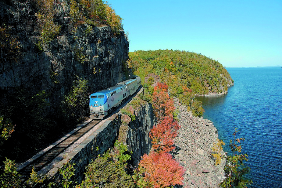 Adirondack Amrak Train Route over cliff and autumn leaves