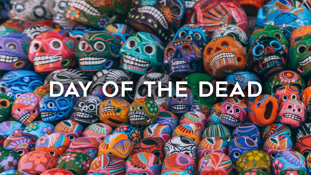 Day of the dead written over colorful skull souvenirs