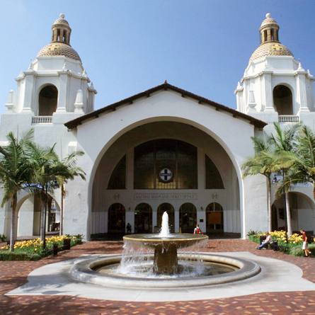 San Diego Union Station white facade with one large archway, fountain and two symettrical towers