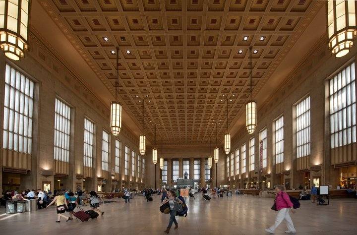 Philadelphia 30th Street Station inside the huge main hall with backpackers on their way to new adventures
