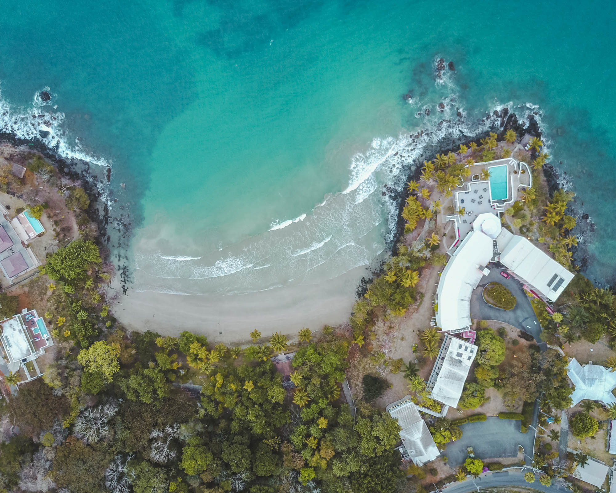 Trinidad and Tobago drone shot over buildings and cove