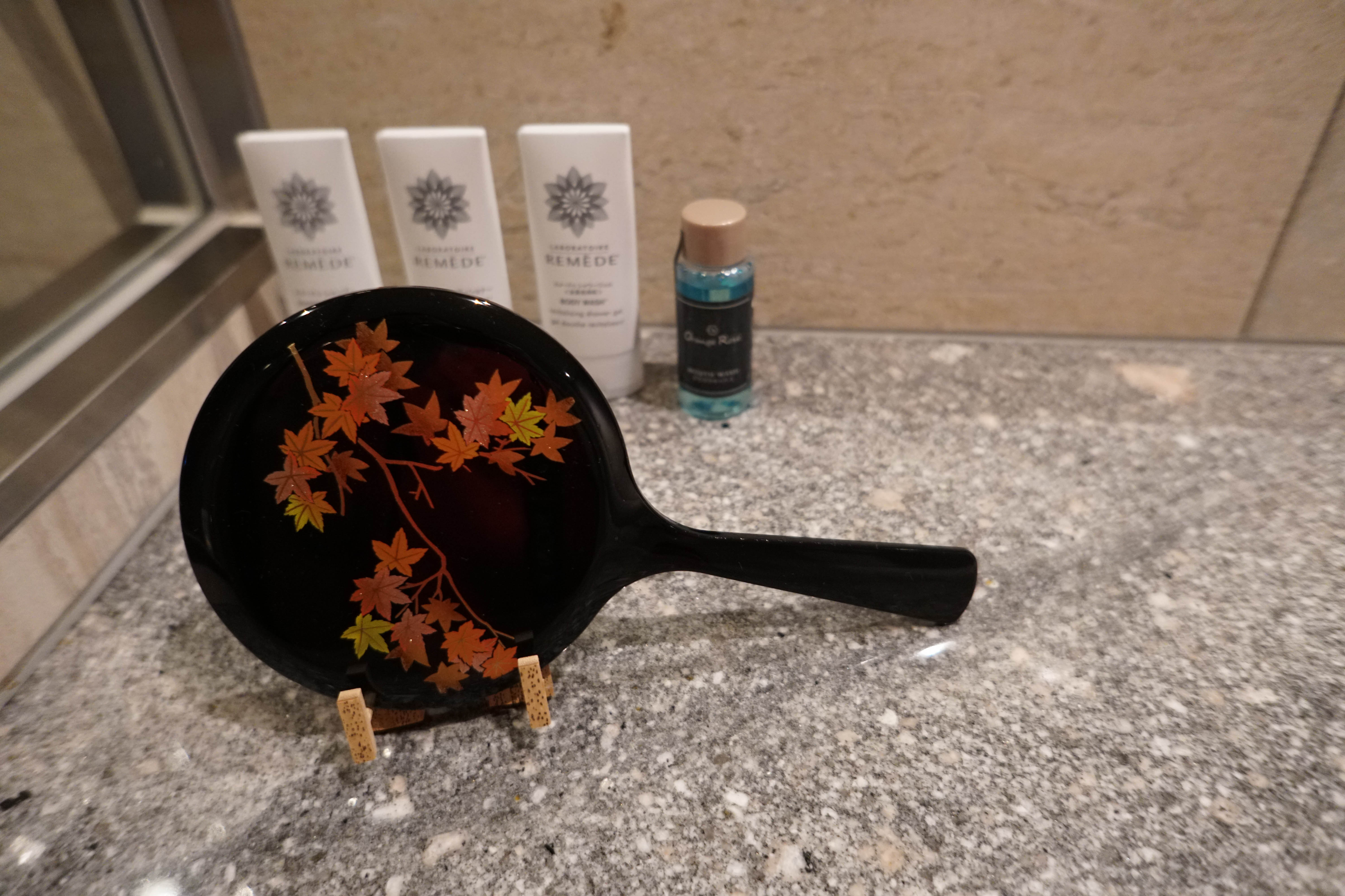 decorative mirror in the bathroom with fall leaves