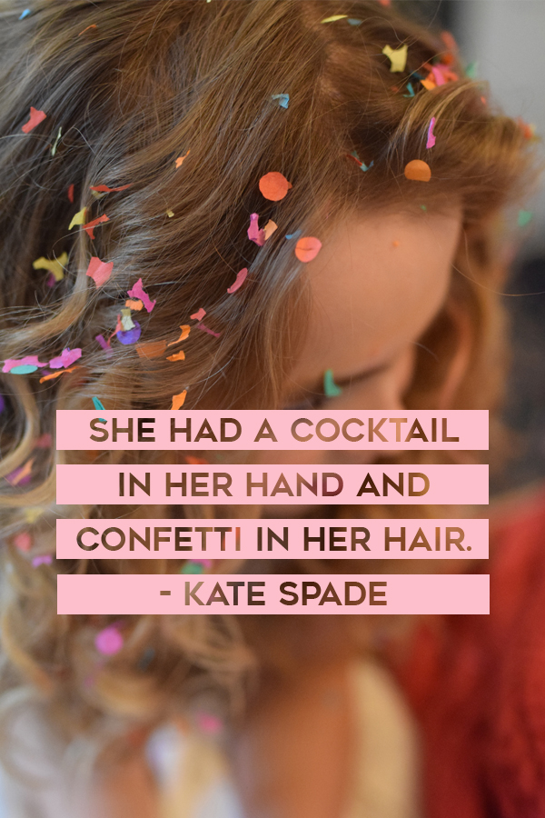 She had a cocktail in her hand and confetti in her hair. Kate Spade The Travel Women