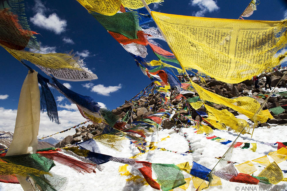 11 Budget Tips to Save Money for Travel Prayer Flags India