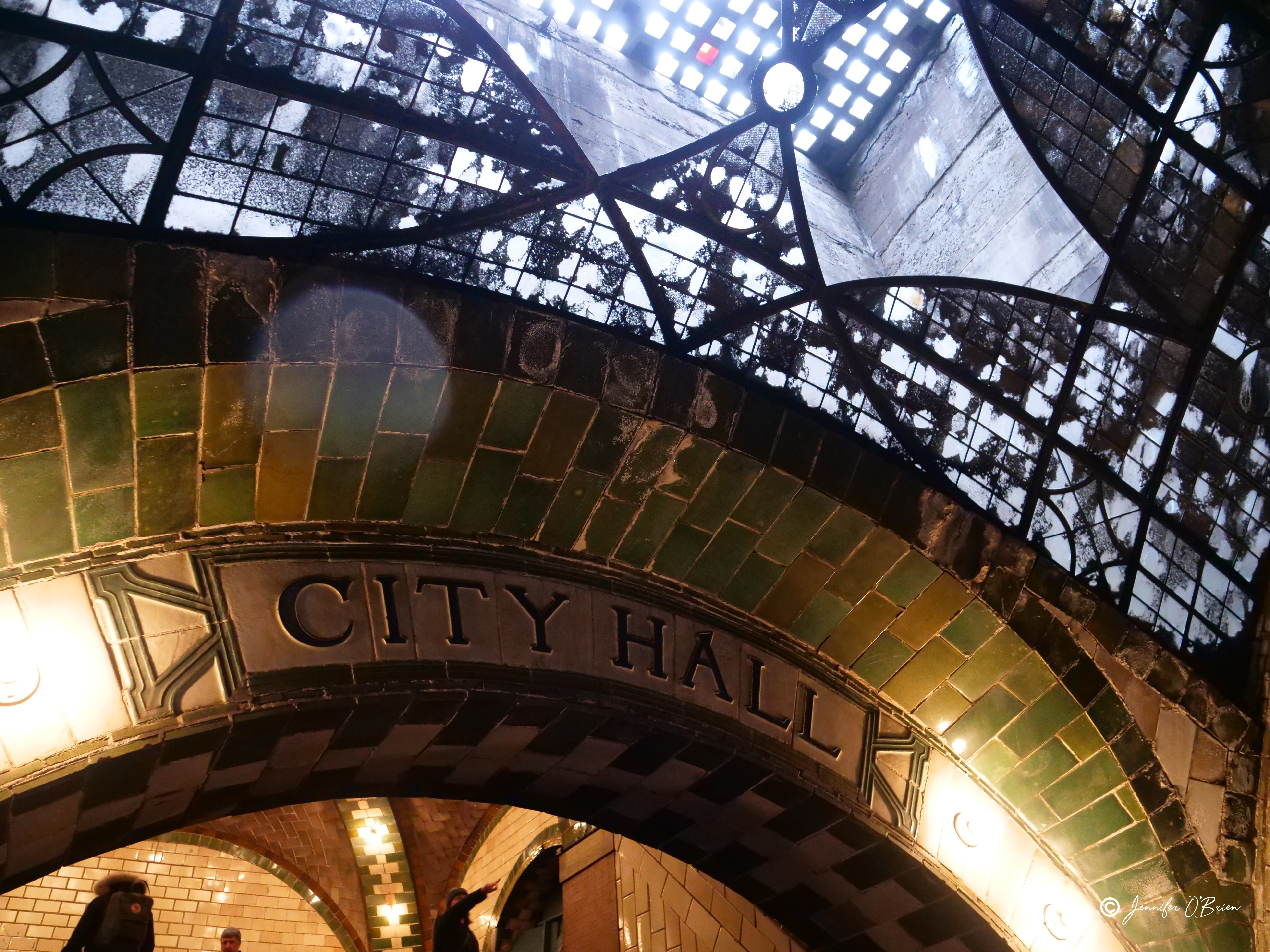 Lady pointing at sign NYC Abandoned City Hall Subway Station Photo Challenge